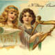 Two vintage angels floating in the clouds with lyre