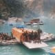 The apple boxe, trucks and passengers being ferried on river rafts in 1998 during cloud brust at Wangtoo in Kinnaur