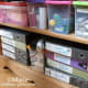The bottom of this solid wood bookcase may look messy with all the craft stash but the whole front is covered with fabric to make it look tidy.