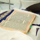 The Holy book of the Sikhs. The Rumala sahib is rolled over and tucked at the top when the Holy book is read.