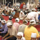 Langar (community food) being served and people sitting in a pangat (on the floor, in rows). The head is always covered when in the Gurudwara premises as a mark of respect to the Lord.
