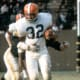 Jim Brown, Cleveland Browns 1963 - 1,863 yards.