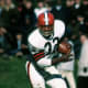 Cleveland Hall of Fame running back Jim Brown (32) gets past New York Giants safety Henry Carr during a 34-21 Browns victory on Nobemver 14, 1965, at Cleveland Municipal Stadium in Cleveland, Ohio. (Photo by Tony Tomsic/NFL)