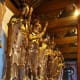 """There were 16 """"saints"""" when Buddhism came to China from India, but over time China added two more of their own, and now there are 18 Luohan - Saints.  They are shown surrounding the Buddhas in the main hall of the temple, and like the saints of Chris"""