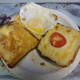Ingredients, three slices of bread, fried egg and toasted cheese, ready to make the Double Decker Toasted Sandwich