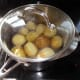 Boiling the potatoes, once they've been washed and any green skin has been removed; otherwise I tend to cook the potatoes with the skins on for a little extra healthy roughage in the diet.