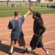 Glenn grabs Jamie by the wrist