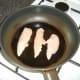 Gently frying chicken breast strips
