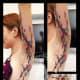 Underarm paint splash tattoo