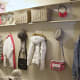 Create a longer open closet using full size painted boards and bathroom hooks.  Plenty of storage now.