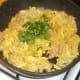Freshly chopped coriander is stirred through fried rice