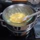 Giving it a quick stir to mix the lemon curd into the white chocolate