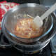 Giving it a quick stir to mix the jam into the white chocolate