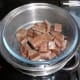 The milk chocolate for the truffles outer coating being melted in the steamer