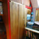 Completed wardrobe in office, with folding door shut