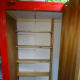The new book case, made from pine floorboards (6 inches depth), in a more accessible location.  On the back wall, the outline of the original pigeonhole shelves, that were previously removed because they were too deep