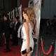 Kate Beckinsale Premiere in Los Angeles in a white short dress and high heels making her way down the red carpet