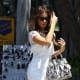 Kate Beckinsale in a white romper and silver heels