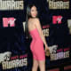 Megan Fox in a hot pink, form fitting, short dress and high heels