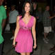 Megan Fox in a short pink dress and high heels