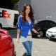 Megan Fox in tight jeans and high heel boots