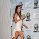 Megan Fox in a short white dress and high heels
