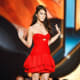 Megan Fox in a short red dress and black stiletto high heels