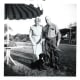 Date of April, 1958. George and Minn Hibbard with their dog, Blackie, in McAllen, Texas while on vacation.