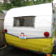 """Glamour camper exterior after our DIY """"$50 Paint Job"""" and polish. John Deere yellow mixed 1:1 with White. Wings & stripe polished with Mother's Polish."""