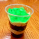 Layer the oreos and pudding. Top with green jello.