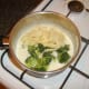 Tagliatelle and broccoli are added to Stilton cheese sauce