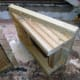 Side View.  Two equal sides, each triangular in shape, with the top end just over an inch shorter than of the height of the decking the ramp will be used for.