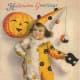 Free vintage Halloween card: little boy clown with pumpkin