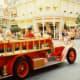 Red firetruck offering transportation in Main Street USA