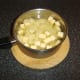 Diced potatoes and Swede are added to strained chicken broth