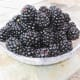 A bowl of scrumptious blackberries picked off the vine.