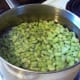Get the lima beans going first.  Add to 6 cups boiling water.  Boil for 10 minutes, then drain.
