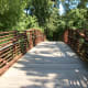 The overhead bridge entrance to the Four Mile Creek Greenway.  This bridge goes over a creek.