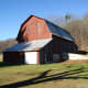 the traditional gambrel roof shape served a practical purpose. It increased the space for storing hay in the hay loft.