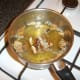 Porcini mushrooms and onion added to chicken stock