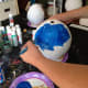 Blue metallic acrylic paint looks really neat for Planet Earth.