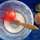 Paint glue mixture onto the balloon.