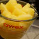 Add the pineapple chunks to a large pitcher or serving bowl.