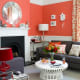 Coral Colored Wall with a Blend of Grey Furnitures & Red Lamp. Unique Combination!