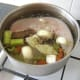 Cold water is added to the pot until the tongue is comfortably covered