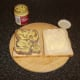 Dijon mustard is spread on the beef tongue