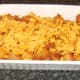 Grated cheese is scattered over spicy beef and pasta