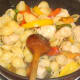 Conchiglie pasta is stirred through spicy chicken and peppers