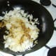 Cooled rice is added to stir fried biryani duck