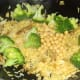 Broccoli and chickpeas are added to duck leg biryani